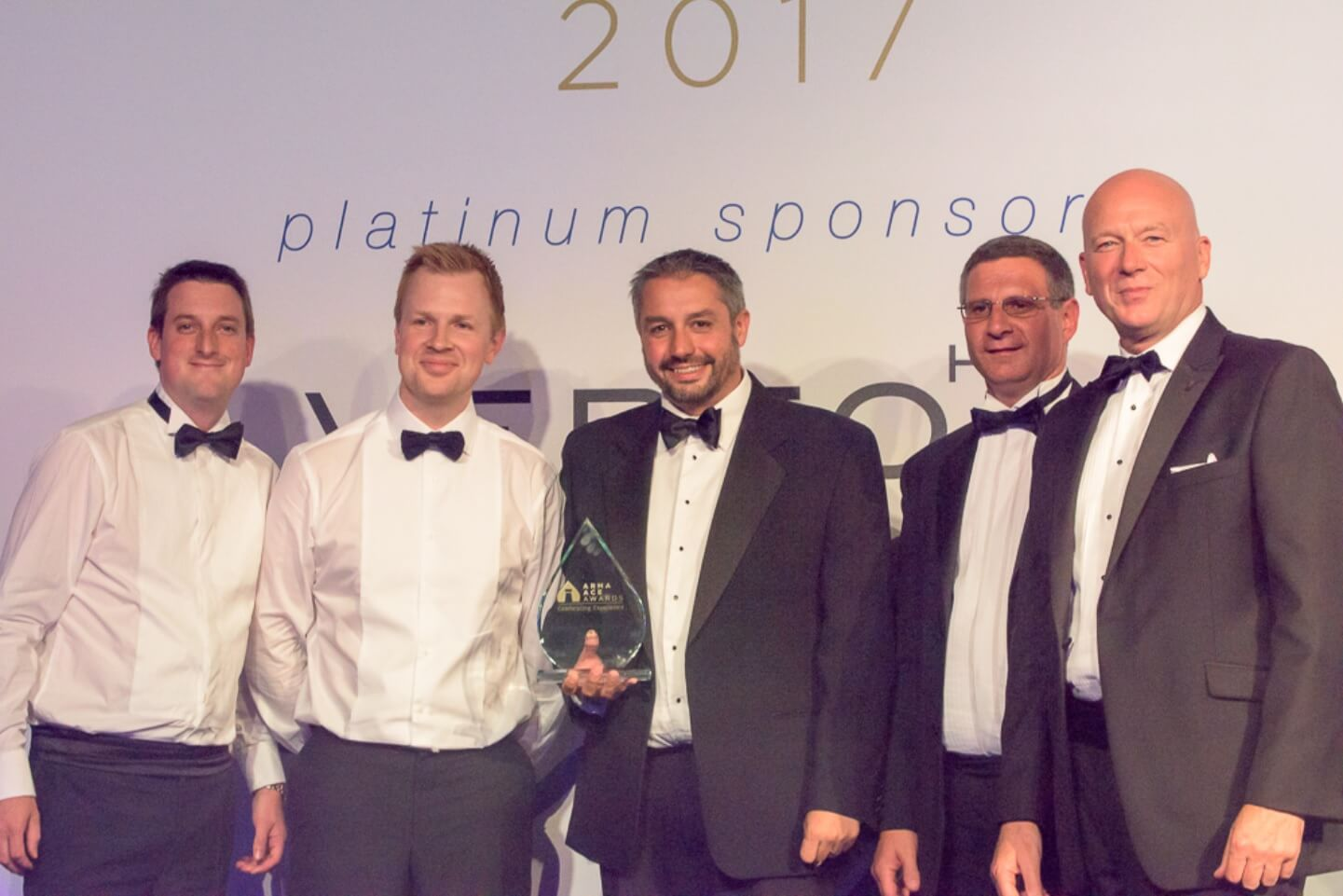 Photo of Daniel Pollard and Robert Prichard accepting Best medium sized Managing Agent in UK Award at the Association of Residential Managing Agents' (ARMA) Ace awards.