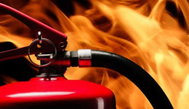Image of a fire extinguisher and flames of a fire