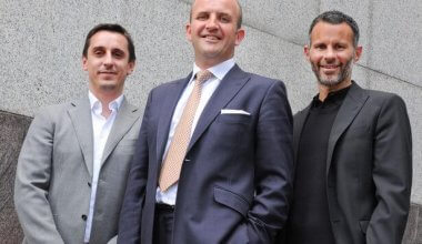 A photo of a group of footballers wearing suits