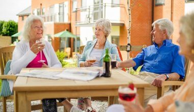 Photo of a group of retired people chatting around a table