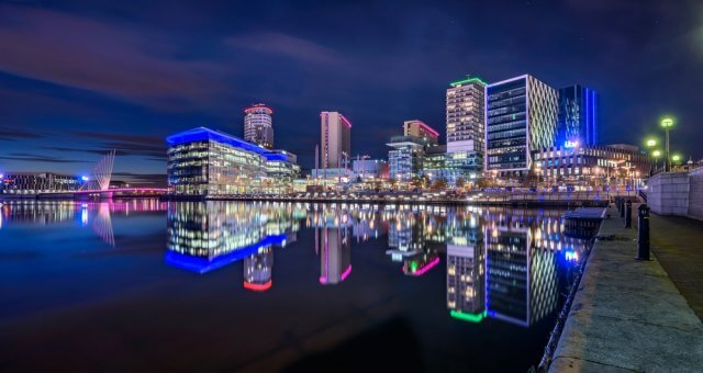 Photo of a city at night time with neon lighting