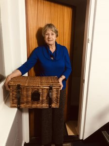 Photo of competition winner holding prize hamper